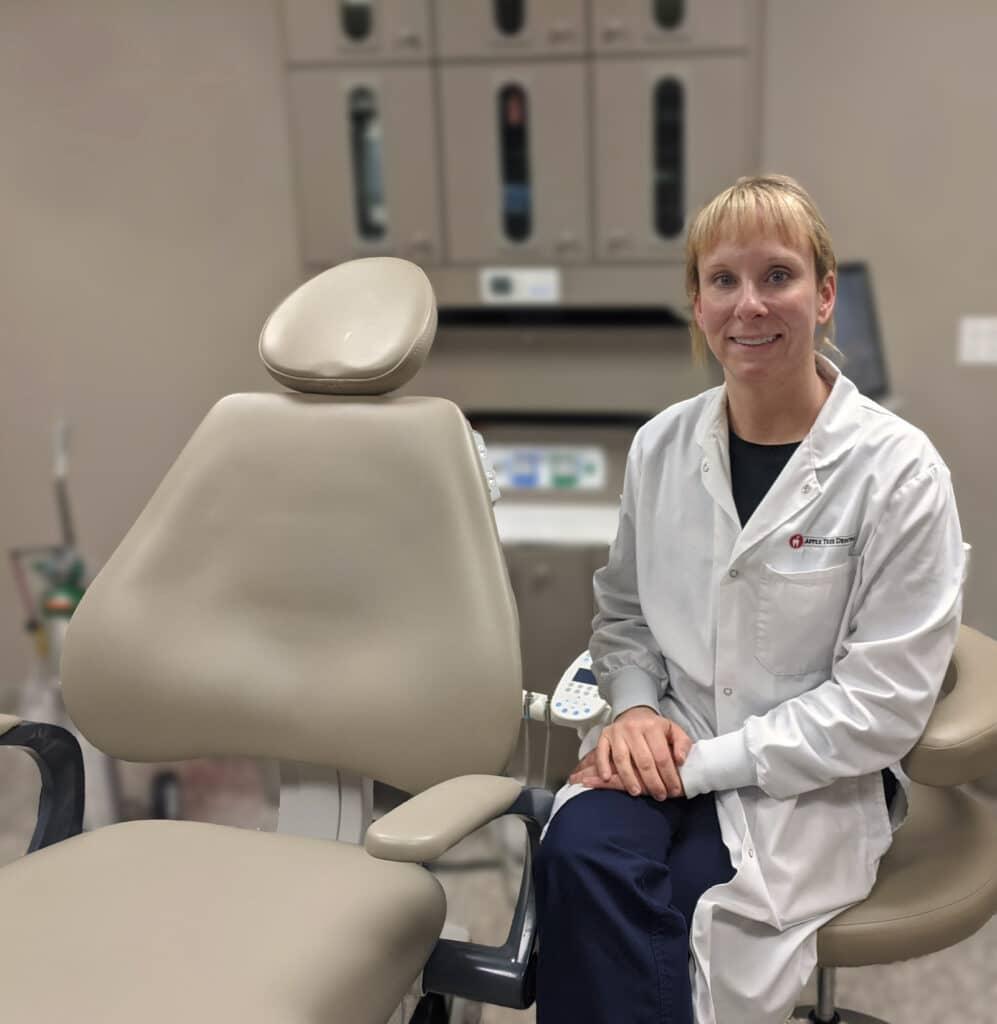 Heather Luebben pictured next to a dental chair
